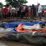 Tropical Storm hit Northern Mindanao-Flood-hit Mindanao residents prepare to bury dead