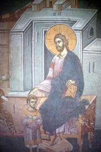 Detail of fresco depicting Christ holding St.Ignatius as a child.