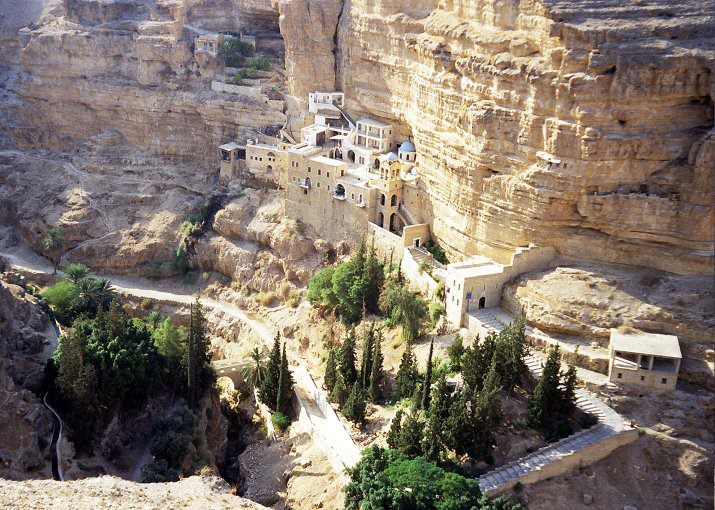 The Monastery of St. George of Choziba, shown here, is a few kilometers from Jericho along the valley known as Wadi Kelt. The Monastery is open to visitors and is richly decorated and quite serene. It is buit at the cave in which Elias was said to have wanted to perish but was fed by a raven who brought him food.